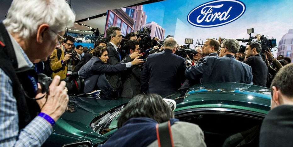 Members of the media interview Jim Hackett, President and CEO of Ford Motor Company in front of Ford's new 2019 Mustang Bullitt at the North American International Auto Show, Sunday, Jan. 14, 2018, in Detroit.