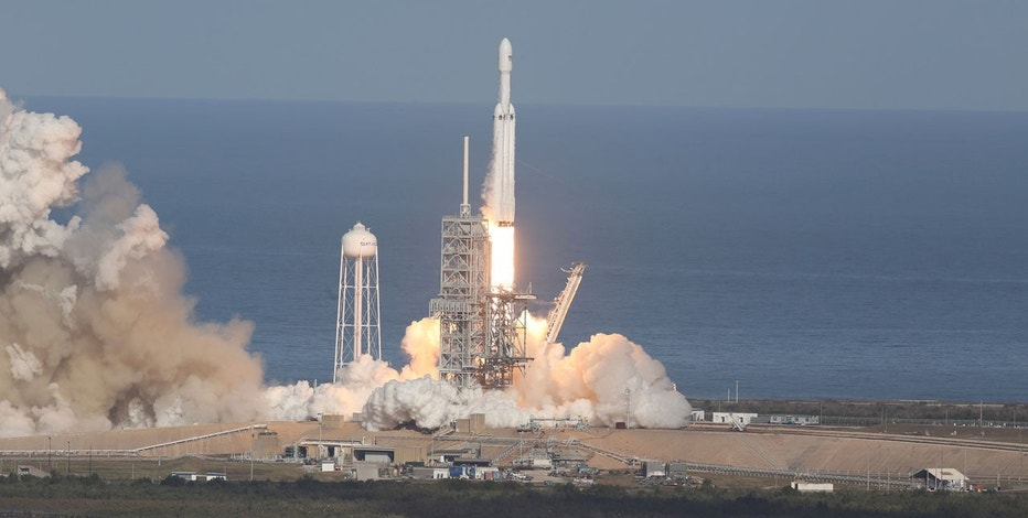 Elon Musk's Falcon Heavy rocket launches successfully class=
