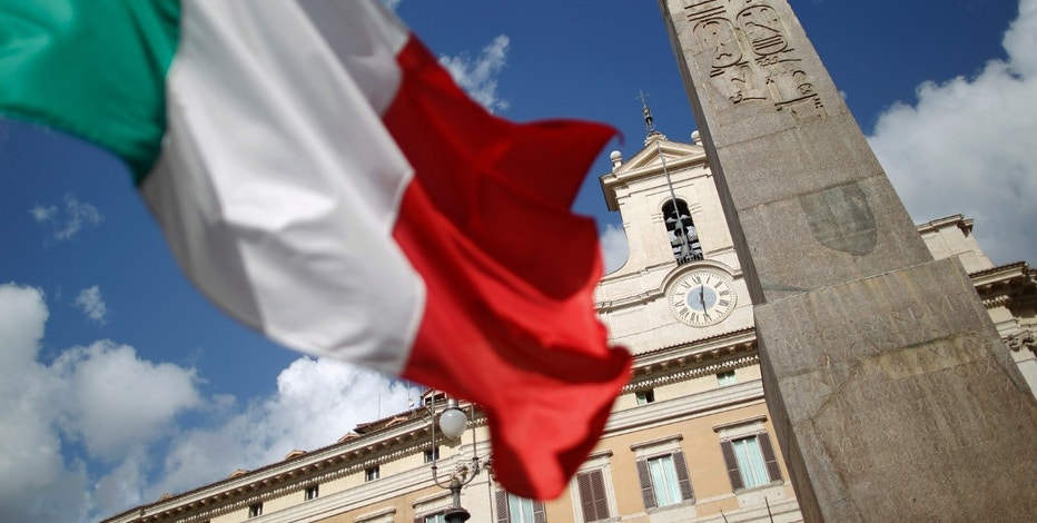 An Italian flag waves in front of the Montecitorio palace before the start of a finances vote in downtown Rome November 8, 2011. Italian Prime Minister Silvio Berlusconi, under massive pressure to resign, faces a crucial vote on public finances in parliament on Tuesday which could sink his government if enough party rebels desert him.