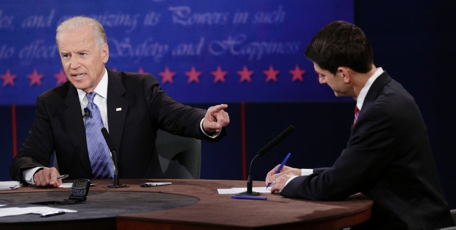 U.S. Vice President Joe Biden (L) points at Republican vice presidential nominee Paul Ryan during the U.S. vice presidential debate in Danville, Kentucky, October 11, 2012. REUTERS/John Gress (UNITED STATES  - Tags: POLITICS ELECTIONS USA PRESIDENTIAL ELECTION)