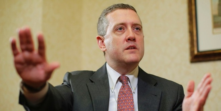 James Bullard, President of the St. Louis Federal Reserve Bank, speaks during an interview with Reuters in Boston, Massachusetts August 2, 2013. Bullard said on Friday that the U.S. economy is improving modestly but needs to gather more steam, while inflation remained too low for comfort, underscoring the debate within the central bank over when to scale back stimulus. REUTERS/Brian Snyder  (UNITED STATES - Tags: BUSINESS) - RTX128AB