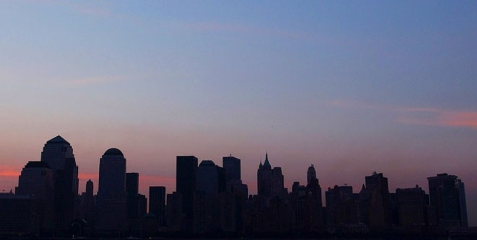 Manhattan skyline seen at sunrise on August 16, 2003, the morning after the worst blackout in North American history.