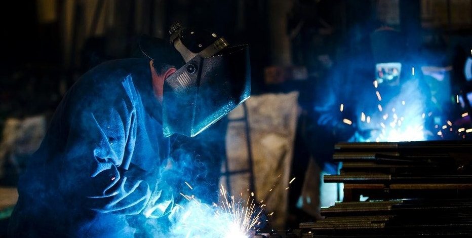 In this July 16, 2014 photo, welders fabricate anchor bolts for roads and bridges at the custom manufacturer Fox Company Inc. in Philadelphia. The Commerce Department reports on U.S. factory orders in June on Tuesday, Aug. 5, 2014. (AP Photo/Matt Rourke)