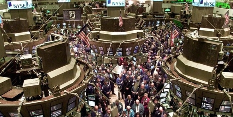 Traders observe a moment of silence in honor of the victims of the World Trade Tower disaster on the floor of the New York Stock Exchange in New York September 17, 2001.