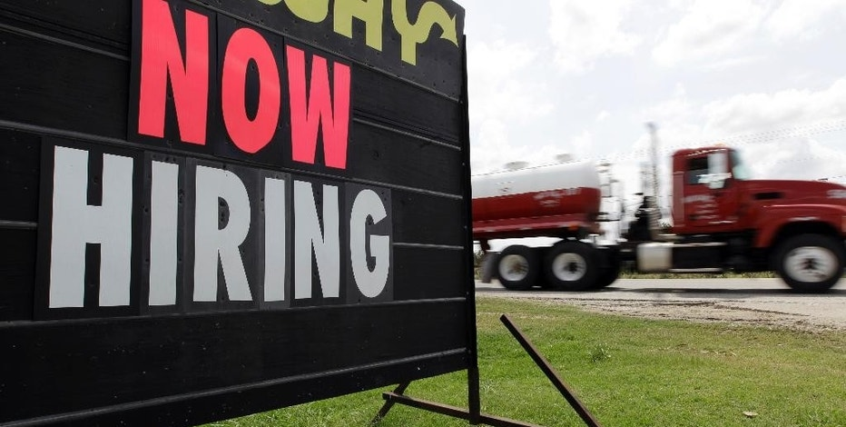 "FILE - In this May 9, 2012 file photo, an oil truck passes a ""now hiring"" sign in Kennedy, Texas. With the Federal Reserve edging into the spotlight, the Friday, Sept. 4, 2015 jobs report could trigger changes in Americans' financial lives. (AP Photo/Eric Gay, File)"
