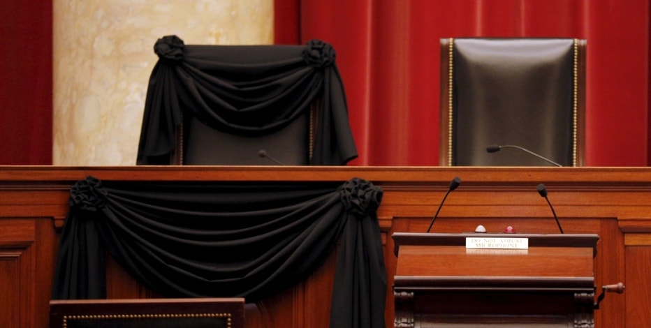 The bench of late Supreme Court Justice Antonin Scalia is seen draped with black wool crepe in memoriam inside the Supreme Court in Washington, February 16, 2016. REUTERS/Carlos Barria - RTX278NP