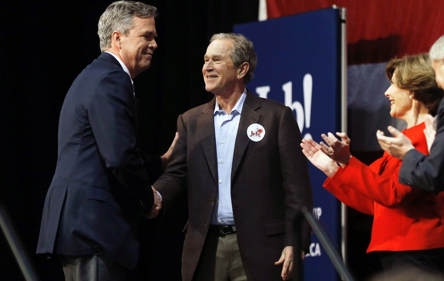 Republican presidential candidate and former Florida Gov. Jeb Bush, left, shakes hands with his brother former President George W. Bush as Laura Bush and Sen. Lindsey Graham, R-S.C., look on during a campaign stop Monday, Feb. 15, 2016, in North Charleston, S.C. (AP Photo/Matt Rourke)