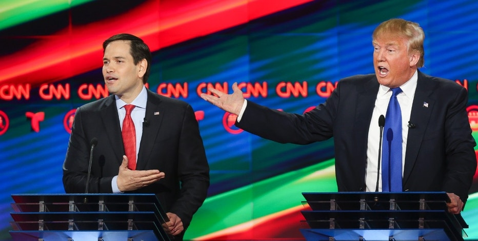 Republican presidential candidates, Sen. Marco Rubio, R-Fla, left, and businessman Donald Trump argue while answering a question during the Republican Presidential Primary Debate at the University of Houston Thursday, Feb. 25, 2016, Houston. (AP Photo/Houston Chronicle, Gary Coronado, Pool) MANDATORY CREDIT