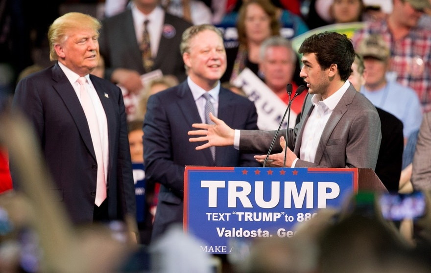 NASCAR Driver Chase Elliott, accompanied by Republican presidential candidate Donald Trump, left, and NASCAR Chairman and CEO Brian France, second from left, speaks at a Trump rally at Valdosta State University in Valdosta, Ga., Monday, Feb. 29, 2016.