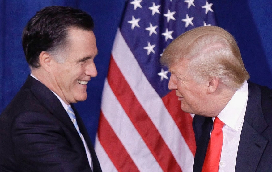 FILE - In this Feb. 2, 2012 file photo, Donald Trump greets then-Republican presidential candidate, former Massachusetts Gov. Mitt Romney, after announcing his endorsement of Romney, during a news conference in Las Vegas. In an extraordinary display of Republican division, the Republican Party's 2012 presidential ticket took on its 2016 front-runner on Thursday, March 3, 2016, as Mitt Romney joined the escalating charge to stop Donald Trump. (AP Photo/Julie Jacobson, File)