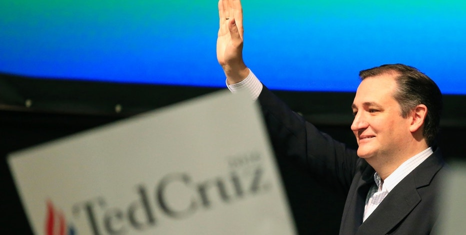Republican presidential candidate, Sen. Ted Cruz, R-Texas waves to the crowd at the GOP caucus in Wichita, Kan., Saturday, March 5, 2016. (AP Photo/Orlin Wagner)