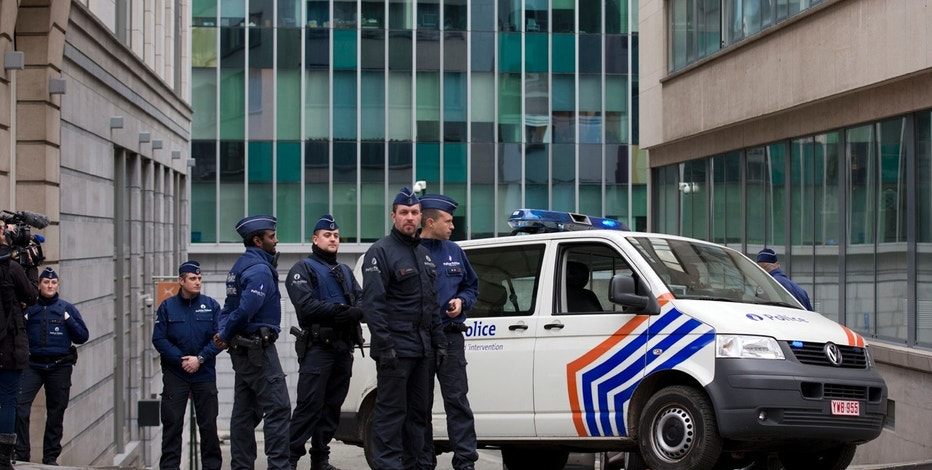 Security forces guard a street leading to the federal police headquarters where captured fugitive Salah Abdeslam appeared before a judge in Brussels, Belgium, Saturday, March 19, 2016. Abdeslam, the top suspect in last year's deadly Paris attacks, was arrested after a four-month manhunt with a suspected accomplice and both men have been discharged from a hospital in Brussels and will now face official questioning and a fast-track extradition effort. Abdeslam and his companion were injured when they were captured by police. (AP Photo/Peter Dejong)