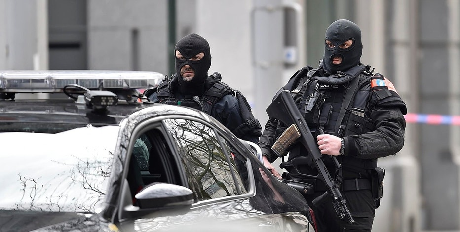 Special police secure the city center in Brussels, Belgium, Tuesday, March 22, 2016.  Authorities locked down the Belgian capital on Tuesday after explosions rocked the Brussels airport and subway system, killing  a number of people and injuring many more. Belgium raised its terror alert to its highest level, diverting arriving planes and trains and ordering people to stay where they were. Airports across Europe tightened security. (AP Photo/Martin Meissner)