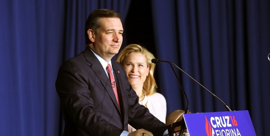 Republican U.S. presidential candidate Ted Cruz announces that he is dropping out of the 2016 race for the Republican presidential nomination as his wife Heidi looks at his Indiana primary night rally in Indianapolis, Indiana, U.S. May 3, 2016.