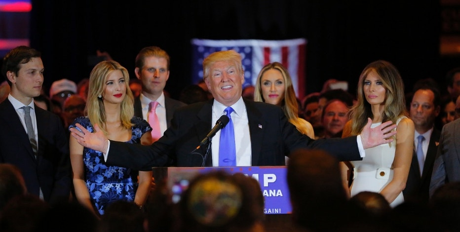 Republican U.S. presidential candidate Donald Trump speaks as (L-R) his son-in-law Jared Kushner, his daughter Ivanka, his son Eric, Eric's wife Lara Yunaska and Trump's wife Melania  look on, during a campaign victory party after rival candidate Senator Ted Cruz dropped out of the race for the Republican presidential nomination following the results of the Indiana state primary, at Trump Tower in Manhattan, New York, U.S., May 3, 2016. REUTERS/Lucas Jackson - RTX2CPLV