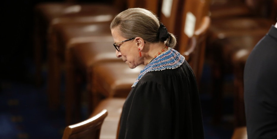 U.S. Supreme Court Associate Justice Ruth Bader Ginsburg arrives to watch U.S. President Barack Obama's State of the Union address to a joint session of the U.S. Congress on Capitol Hill in Washington, January 20, 2015. REUTERS/Joshua Roberts (UNITED STATES  - Tags: POLITICS)   - RTR4M8I6