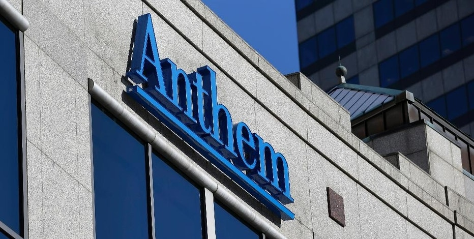 FILE - In this Feb. 5, 2015 file photo, the Anthem logo hangs at the health insurer's corporate headquarters in Indianapolis. Insurers aren't required to encrypt consumers' data under a 1990s federal law that remains the foundation for health care privacy in the Internet age _ a striking omission in light of the cyberattack against Anthem, the nation's second-largest health insurer.  (AP Photo/Michael Conroy, File)