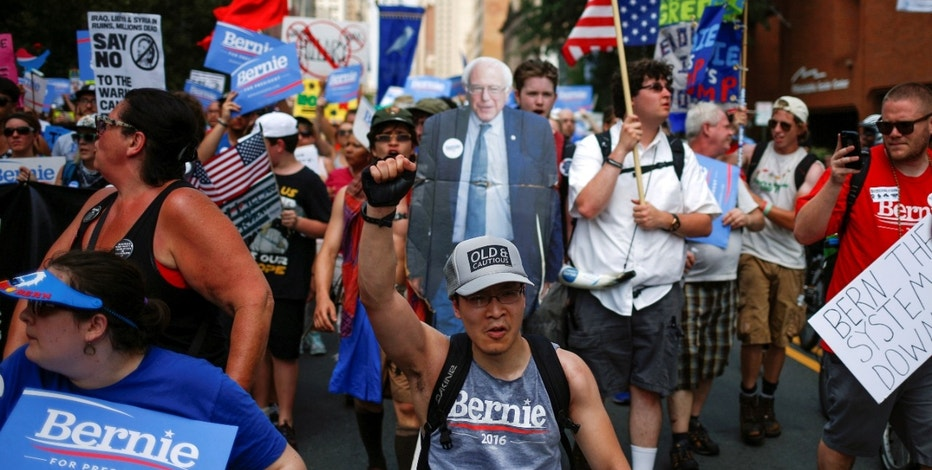 Demonstrators from various groups, including supporters of U.S. Senator Bernie Sanders, take part in a protest march on the first day of the 2016 Democratic National Convention in Philadelphia, Pennsylvania, U.S. July 25, 2016. REUTERS/Adrees Latif - RTSJL70