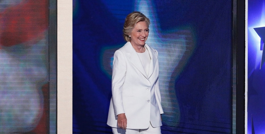 Democratic presidential nominee Hillary Clinton steps to the stage before speaking during the final day of the Democratic National Convention in Philadelphia , Thursday, July 28, 2016. (AP Photo/J. Scott Applewhite)