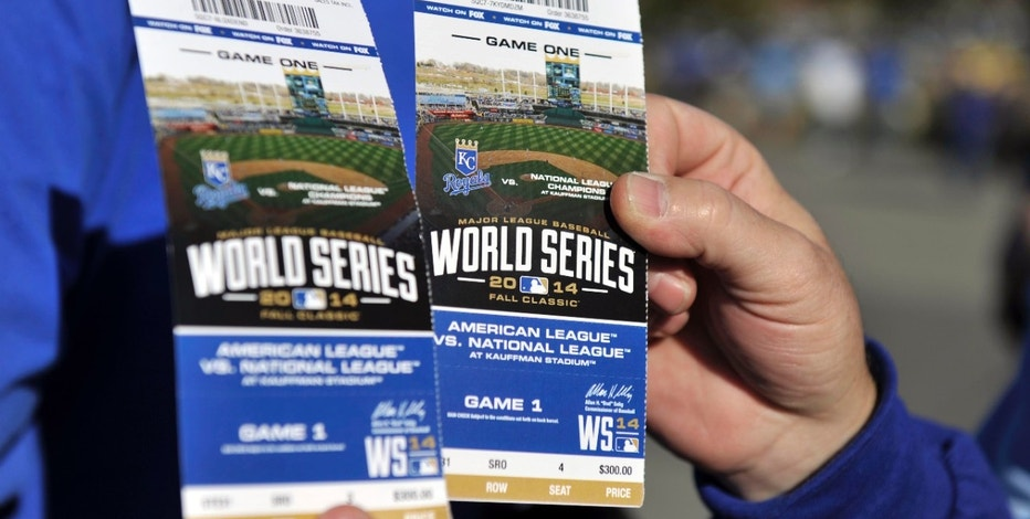 Oct 21, 2014; Kansas City, MO, USA; A fan holds up his baseball game tickets before game one of the 2014 World Series between the Kansas City Royals and the San Francisco Giants at Kauffman Stadium. Mandatory Credit: Christopher Hanewinckel-USA TODAY Sports - RTR4B2LU