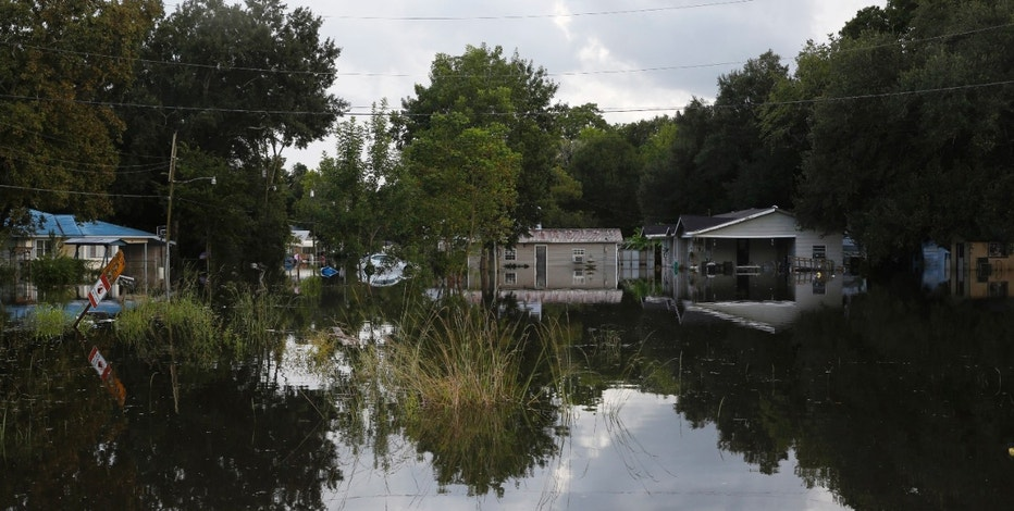 Floodwaters cover streets of a residential area in Sorrento, Louisiana, U.S. August 17, 2016. REUTERS/Edmund D. Fountain - RTX2LNO2