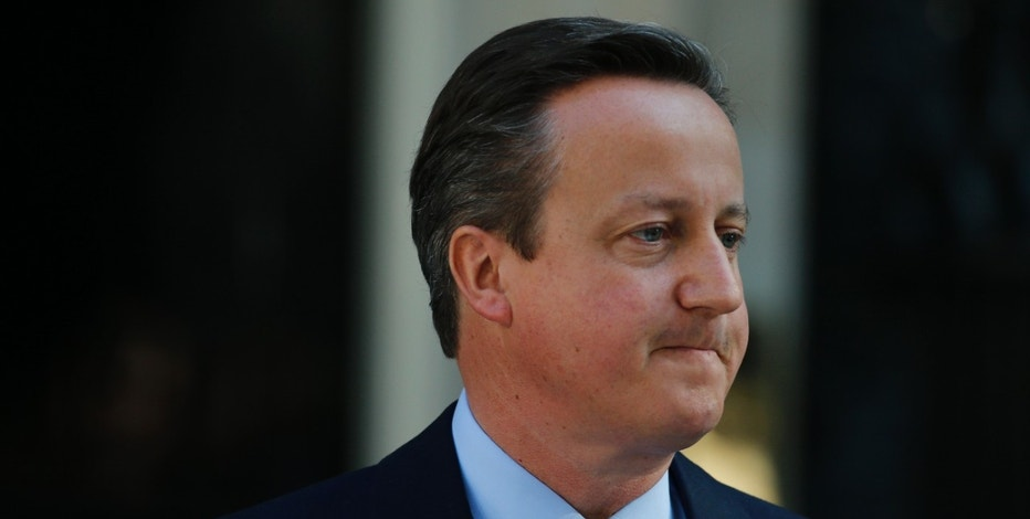 Britain's Prime Minister David Cameron turns away after speaking to the media in front of 10 Downing Street, London, Friday, June, 24, 2016, where he announced he will resign by the time of the Conservative Party conference in the autumn, following the result of the EU referendum, in which the Britain voted to leave the EU. (AP Photo/Alastair Grant)