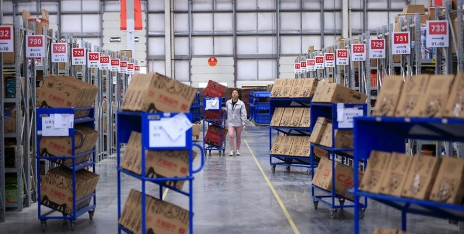 An employee works at a Tmall logistic centre in Suzhou, Jiangsu province, China, October 28, 2015. REUTERS/Aly Song/File Photo