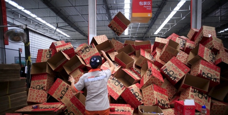 An employee works at a Tmall logistic centre in Suzhou, Jiangsu province, China, October 28, 2015. Picture taken October 28, 2015. REUTERS/Aly Song/File Photo