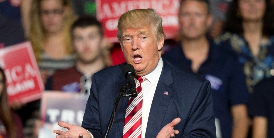 Republican presidential candidate Donald Trump gestures to the crowd during a rally in Roanoke, Va., Saturday, Sept. 24, 2016. Trump faces Democratic opponent Hillary Clinton in the first of three debates Monday. (AP Photo/Steve Helber)