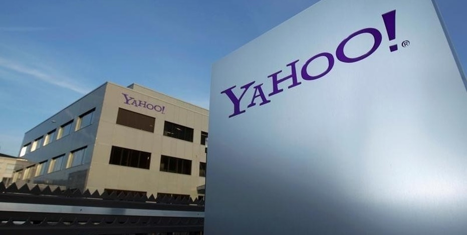 A Yahoo logo is pictured in front of a building in Rolle, 30 km (19 miles) east of Geneva, December 12, 2012.   REUTERS/Denis Balibouse/File photo