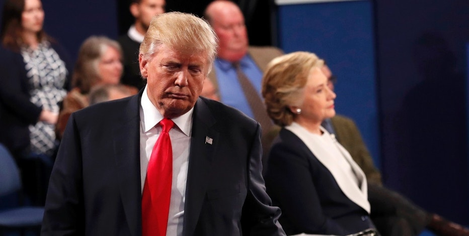 Republican U.S. presidential nominee Donald Trump and Democratic U.S. presidential nominee Hillary Clinton pause during their presidential town hall debate at Washington University in St. Louis, Missouri, U.S., October 9, 2016. REUTERS/Rick Wilking