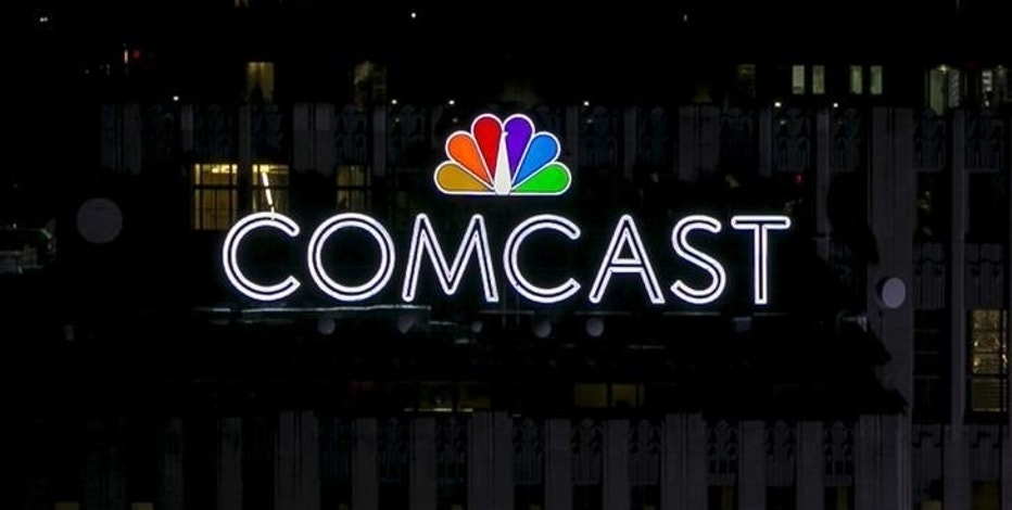 The NBC and Comcast logo are displayed on top of 30 Rockefeller Plaza in midtown Manhattan in New York July 1, 2015.  REUTERS/Brendan McDermid/File Photo