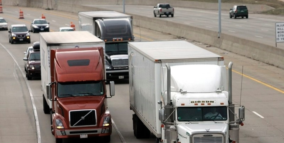 Two freight trucks are driven on the Fisher freeway in Detroit, Michigan, U.S. March 27, 2009. The U.S. recession has turned a seri REUTERS/Rebecca Cook/File Photo