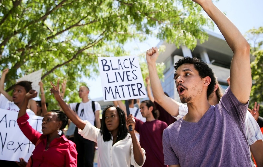 Timothy Knoll, right, joins other protestors in a chant during a Black Lives Matter rally outside the Salt Lake City Public Safety Building, Saturday, July 9, 2016. (Spenser Heaps/Deseret News via AP)