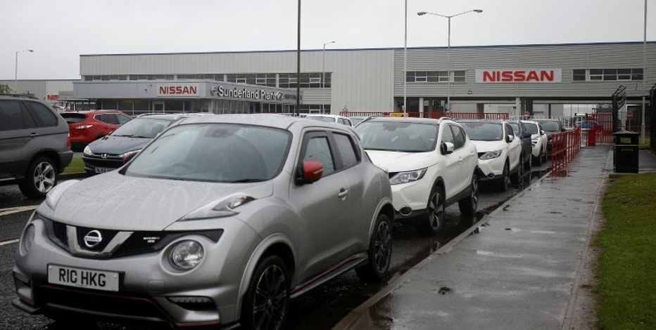 A Nissan logo (in the background) is pictured at a car dealership in Sunderland, Britain June 29, 2016.  Picture taken June 29, 2016. REUTERS/Andrew Yates
