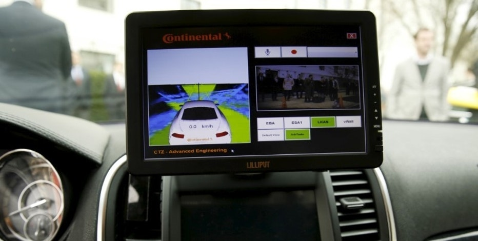 The computer screen in an autonomous prototype Continental Chrysler 300C sedan is seen during an event featuring numerous self-driving cars on Capitol Hill in Washington March 15, 2016.      REUTERS/Gary Cameron
