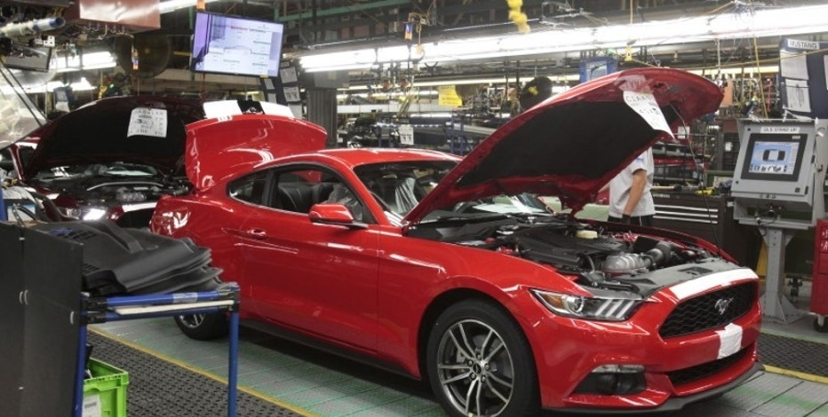 A 2015 Ford Mustang vehicle moves down the production line at the Ford Motor Flat Rock Assembly Plant in Flat Rock, Michigan, August 20, 2015.  REUTERS/Rebecca Cook