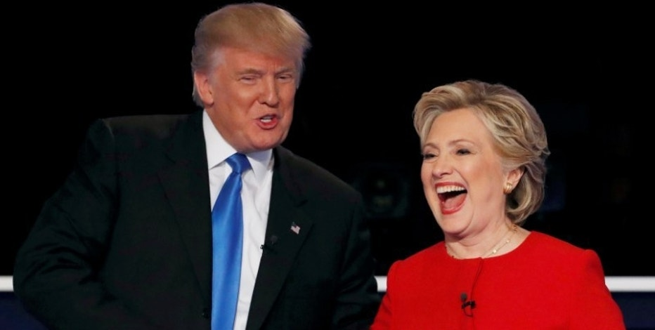 Republican U.S. presidential nominee Donald Trump shakes hands with Democratic U.S. presidential nominee Hillary Clinton at the conclusion of their first presidential debate at Hofstra University in Hempstead, New York, U.S., September 26, 2016. REUTERS/Mike Segar/File Photo - RTX2S3QH