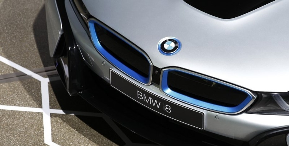 The new BMW i8 plug-in hybrid sports car is parked before the official delivery to the first customer in Munich June 5, 2014.  REUTERS/Michaela Rehle