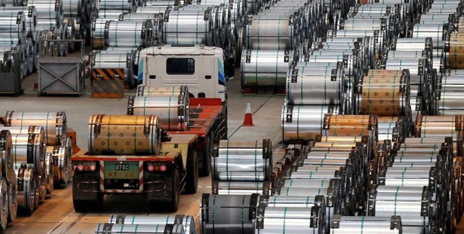 A truck drives past rolls of steel inside the China Steel Corporation factory, in Kaohsiung, southern Taiwan August 26, 2016. REUTERS/Tyrone Siu/File Photo