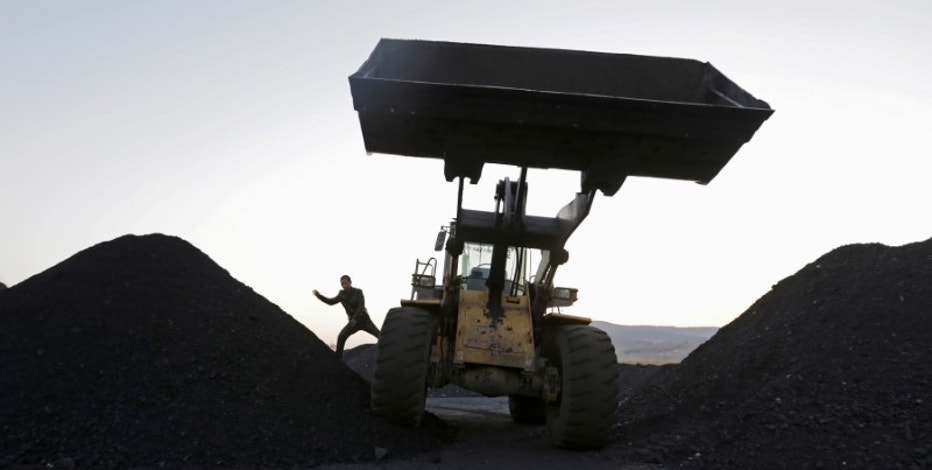 A driver gets off a loading vehicle at local businessman Sun Meng's small coal depot near a coal mine of the state-owned Longmay Group on the outskirts of Jixi, in Heilongjiang province, China, October 23, 2015.  REUTERS/Jason Lee/File Photo