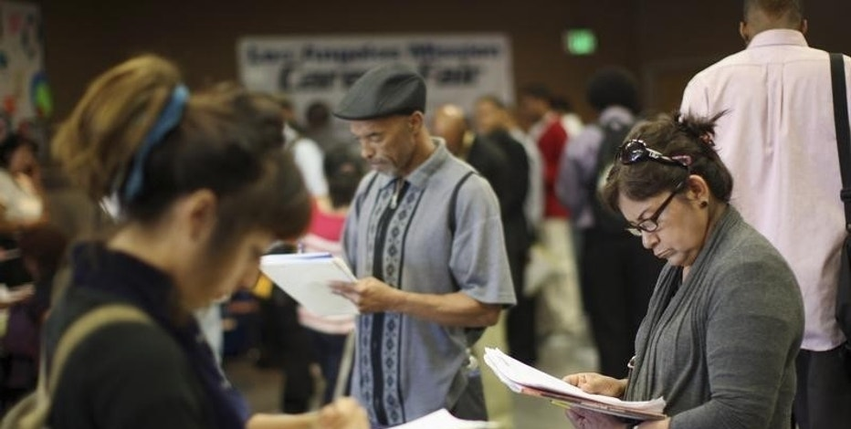 Job seekers fill out applications during the 11th annual Skid Row Career Fair the Los Angeles Mission in Los Angeles, California, U.S. on May 31, 2012.   REUTERS/David McNew/File Photo