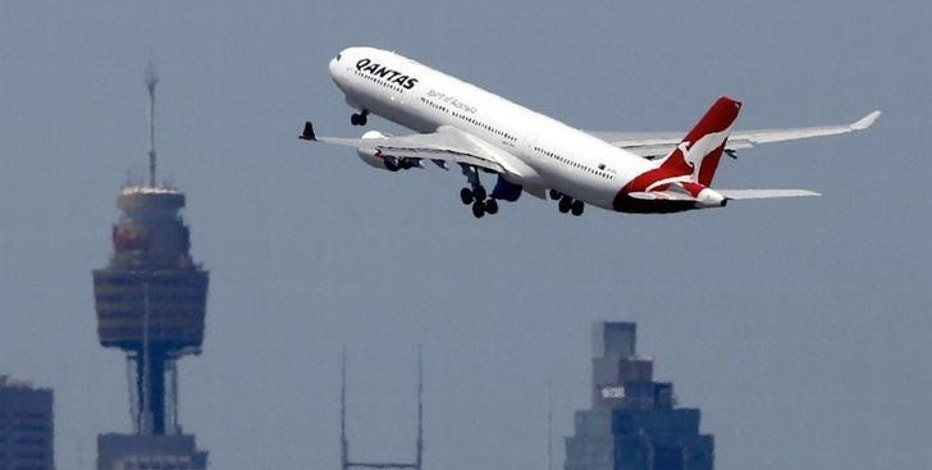 A Qantas Airways Airbus A330-300 jet takes off from Sydney International Airport over the city skyline, December 18, 2015.     REUTERS/Jason Reed/File photo