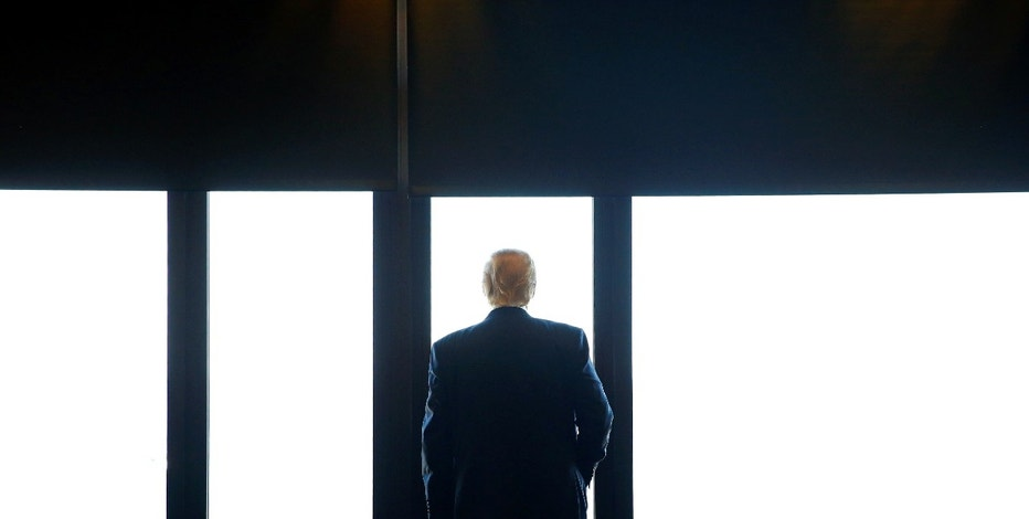Republican U.S. presidential nominee Donald Trump looks out at Lake Michigan during a visit to the Milwaukee County War Memorial Center in Milwaukee, Wisconsin August 16, 2016. REUTERS/Eric Thayer     TPX IMAGES OF THE DAY      - RTX2LC44