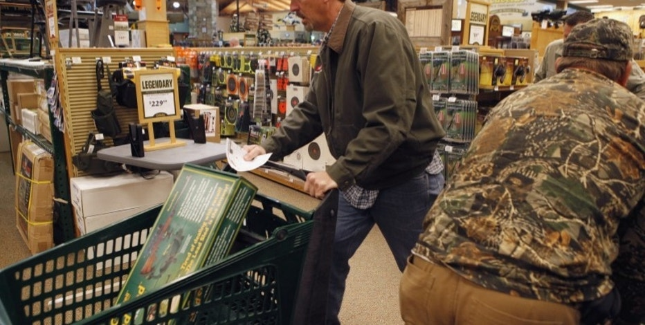 "Shoppers rush to grab items inside a Cabela's store on the shopping day dubbed ""Black Friday"" in Fort Worth, Texas November 27, 2009. REUTERS/Jessica Rinaldi"
