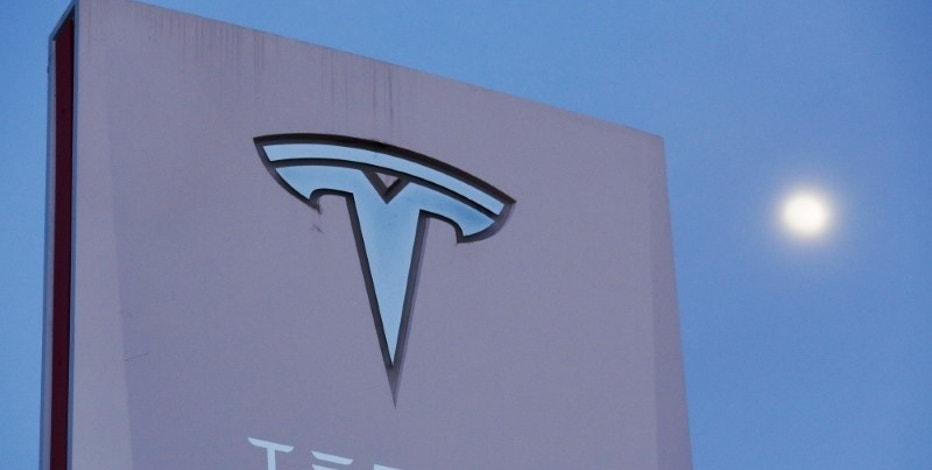 Signage is displayed outside of Tesla Motors before the Tesla Energy Powerwall Home Battery event in Hawthorne, California April 30, 2015. REUTERS/Patrick T. Fallon