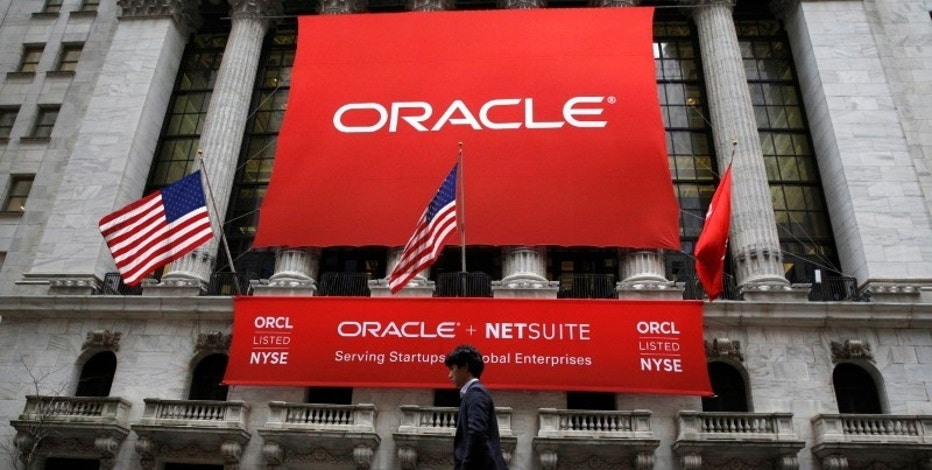 An Oracle banner hangs outside the New York Stock Exchange (NYSE) in New York City, U.S., January 18, 2017.  REUTERS/Brendan McDermid