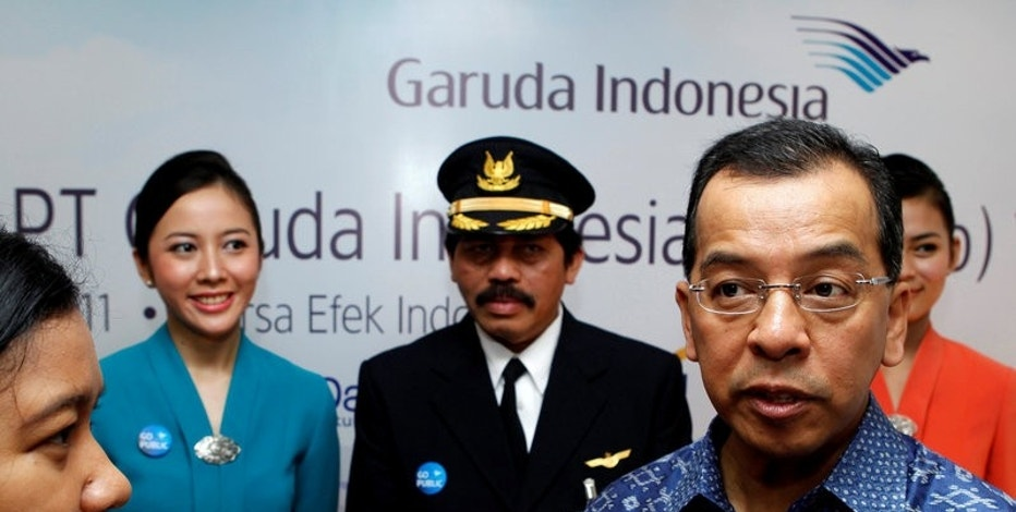 FILE PHOTO Former Chief Executive Officer of Indonesia's Garuda airline Emirsyah Satar, accompanied by airline crew, speaks to reporters during the airline's initial public listing in Jakarta February 11, 2011. REUTERS/Enny Nuraheni/File Photo