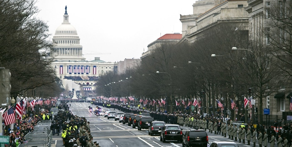 The Presidential motorcade drives on Pennsylvania Avenue to the Capitol for the Inauguration of President-elect Donald Trump, Friday, Jan. 20, 2017, in Washington.