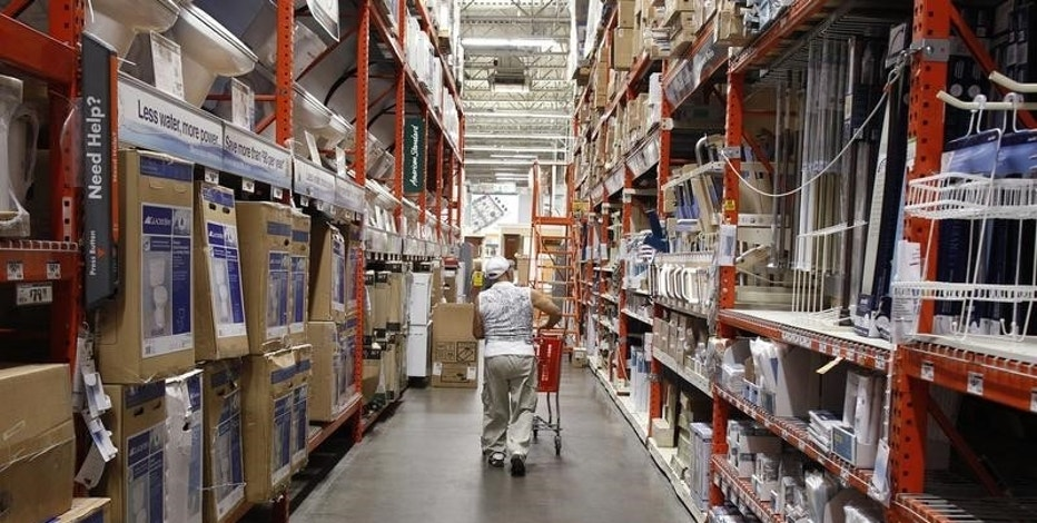 FILE PHOTO: A man pushes his shopping cart down an aisle at a Home Depot store in New York, July 29, 2010.  REUTERS/Shannon Stapleton